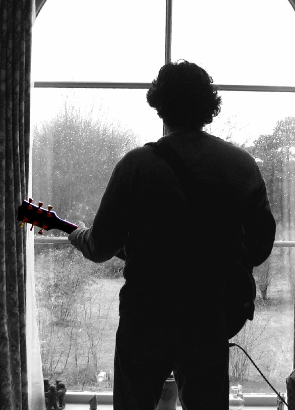 Me at the window with my guitar